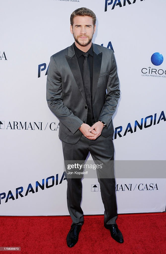 Actor <a gi-track='captionPersonalityLinkClicked' href=/galleries/search?phrase=Liam+Hemsworth&family=editorial&specificpeople=6338547 ng-click='$event.stopPropagation()'>Liam Hemsworth</a> arrives at the Los Angeles Premiere 'Paranoia' at DGA Theater on August 8, 2013 in Los Angeles, California.
