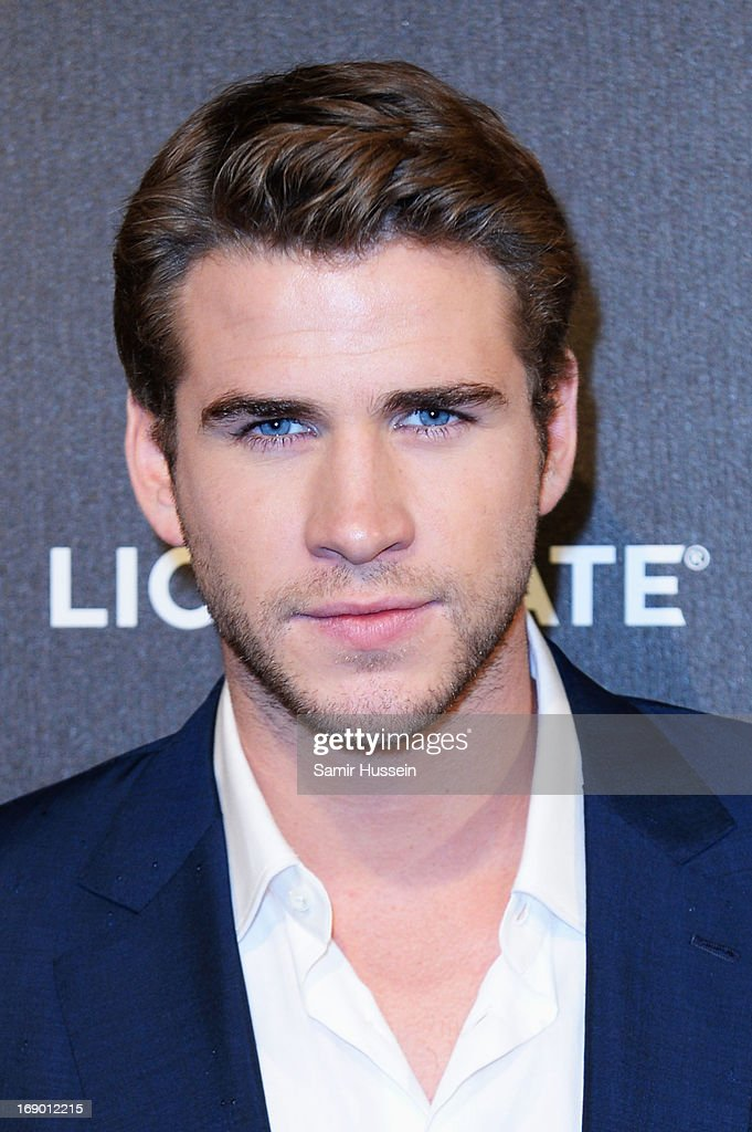 Actor <a gi-track='captionPersonalityLinkClicked' href=/galleries/search?phrase=Liam+Hemsworth&family=editorial&specificpeople=6338547 ng-click='$event.stopPropagation()'>Liam Hemsworth</a> attends 'The Hunger Games: Catching Fire' Party during The 66th Annual Cannes Film Festival at Baoli Beach on May 18, 2013 in Cannes, France.
