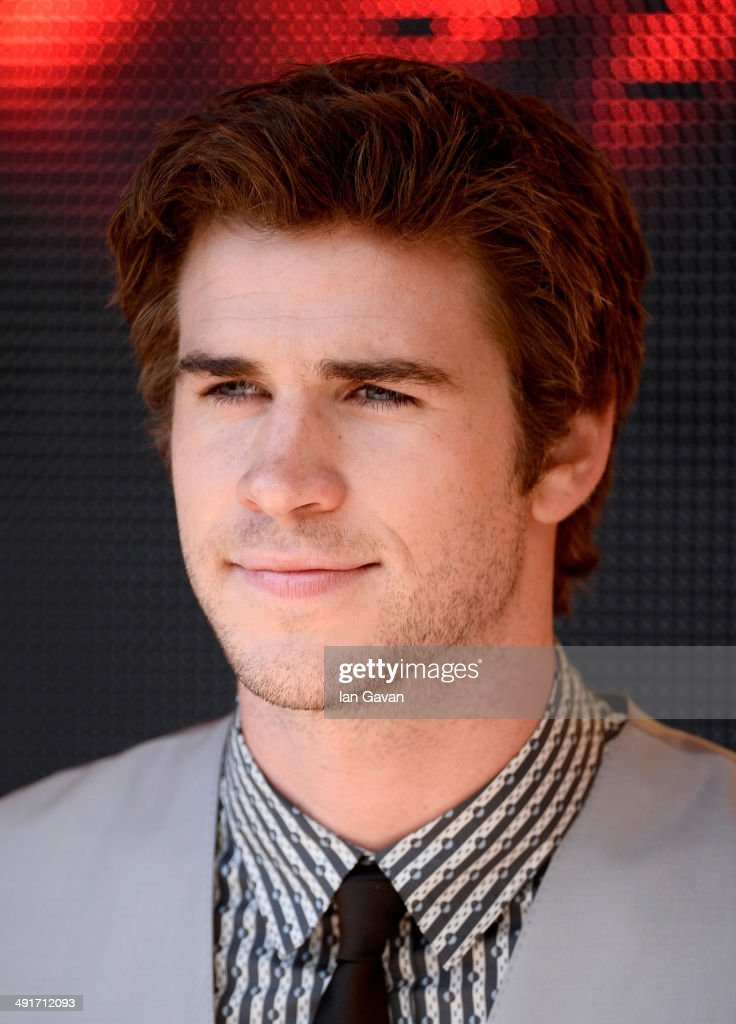 Actor <a gi-track='captionPersonalityLinkClicked' href=/galleries/search?phrase=Liam+Hemsworth&family=editorial&specificpeople=6338547 ng-click='$event.stopPropagation()'>Liam Hemsworth</a> attends 'The Hunger Games: Mockingjay Part 1' photocall at the 67th Annual Cannes Film Festival on May 17, 2014 in Cannes, France.