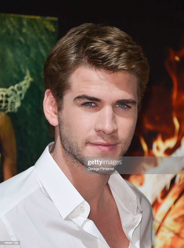 Actor <a gi-track='captionPersonalityLinkClicked' href=/galleries/search?phrase=Liam+Hemsworth&family=editorial&specificpeople=6338547 ng-click='$event.stopPropagation()'>Liam Hemsworth</a> attends the photocall for 'The Hunger Games: Catching Fire' at The 66th Annual Cannes Film Festival at Majestic Hotel on May 18, 2013 in Cannes, France.
