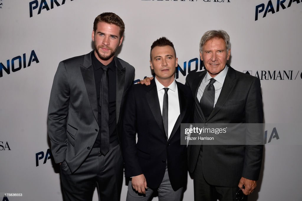 Actor <a gi-track='captionPersonalityLinkClicked' href=/galleries/search?phrase=Liam+Hemsworth&family=editorial&specificpeople=6338547 ng-click='$event.stopPropagation()'>Liam Hemsworth</a>, director <a gi-track='captionPersonalityLinkClicked' href=/galleries/search?phrase=Robert+Luketic&family=editorial&specificpeople=2471533 ng-click='$event.stopPropagation()'>Robert Luketic</a> and actor <a gi-track='captionPersonalityLinkClicked' href=/galleries/search?phrase=Harrison+Ford+-+Actor+-+Born+1942&family=editorial&specificpeople=11508906 ng-click='$event.stopPropagation()'>Harrison Ford</a> attend the premiere of Relativity Media's 'Paranoia' at DGA Theater on August 8, 2013 in Los Angeles, California.