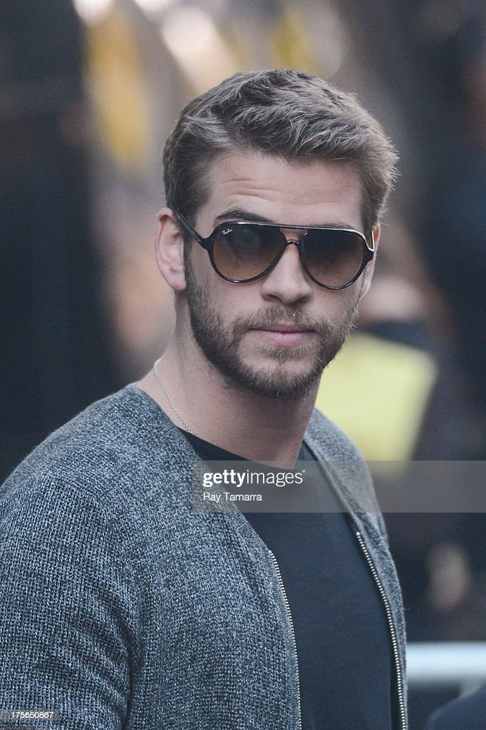Actor <a gi-track='captionPersonalityLinkClicked' href=/galleries/search?phrase=Liam+Hemsworth&family=editorial&specificpeople=6338547 ng-click='$event.stopPropagation()'>Liam Hemsworth</a> leaves the 'Good Morning America' taping at the ABC Times Square Studios on August 5, 2013 in New York City.