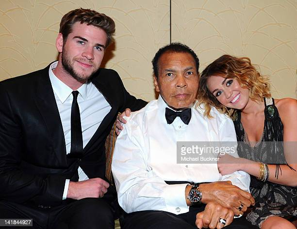 Actor Liam Hemsworth Muhammad Ali and singer Miley Cyrus pose backstage during Muhammad Ali's Celebrity Fight Night XVIII held at JW Marriott Desert...