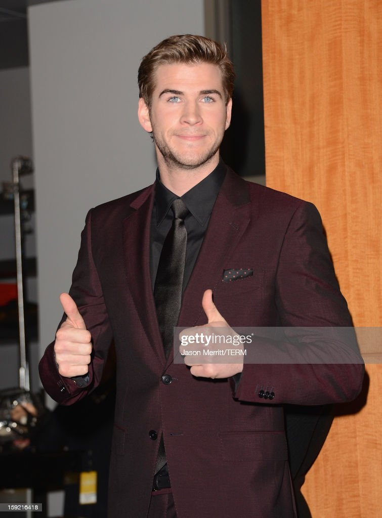 Actor <a gi-track='captionPersonalityLinkClicked' href=/galleries/search?phrase=Liam+Hemsworth&family=editorial&specificpeople=6338547 ng-click='$event.stopPropagation()'>Liam Hemsworth</a> poses in the press room at the 39th Annual People's Choice Awards at Nokia Theatre L.A. Live on January 9, 2013 in Los Angeles, California.