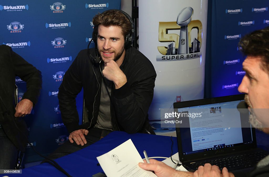 Actor Liam Hemsworth visits SiriusXM host Jim Miller at the SiriusXM set at Super Bowl 50 Radio Row at the Moscone Center on February 4 2016 in San...