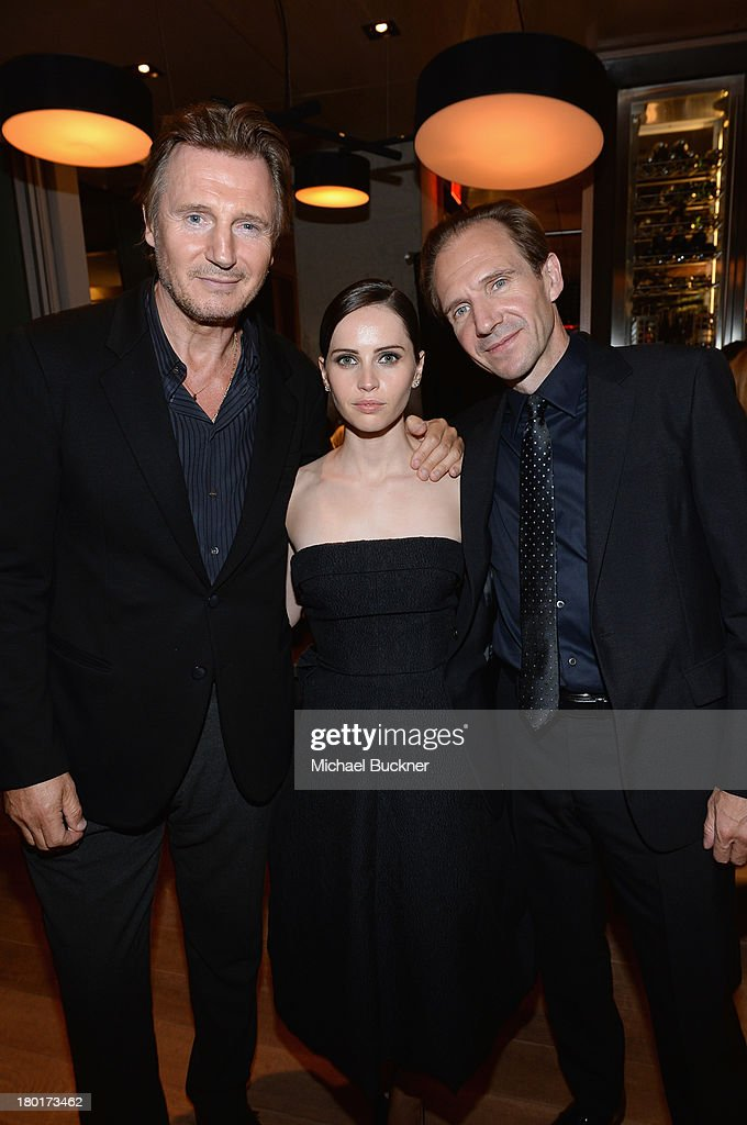 Actor Liam Neeson, actress Felicity Jones and director/actor Ralph Fiennes at the Grey Goose vodka dinner for 'The Invisible Woman' during the 2013 Toronto International Film Festival at Momofuku at the Shangri La on September 9, 2013 in Toronto, Canada.