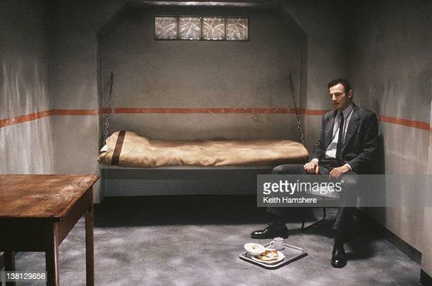Actor Liam Neeson in a prison cell in the thriller 'Under Suspicion' 1991
