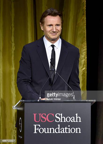 Actor Liam Neeson speaks onstage during USC Shoah Foundation's 20th Anniversary Gala at the Hyatt Regency Century Plaza on May 7 2014 in Century City...