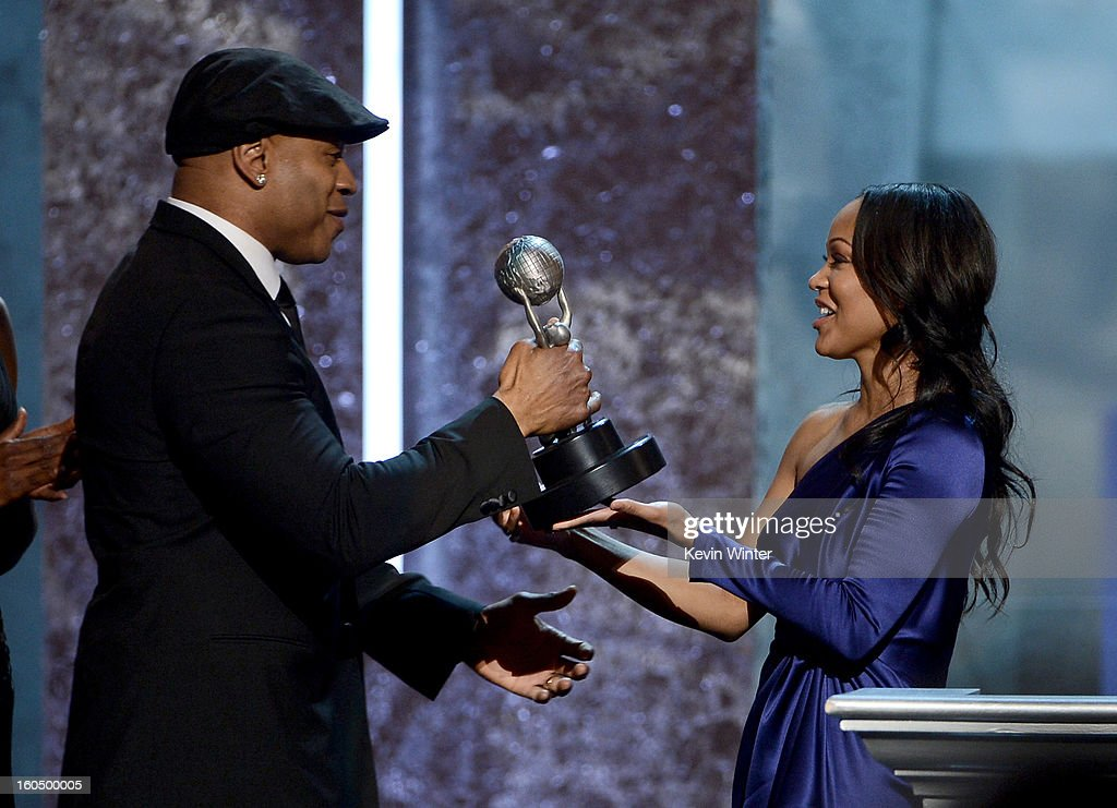 Actor <a gi-track='captionPersonalityLinkClicked' href=/galleries/search?phrase=LL+Cool+J&family=editorial&specificpeople=201567 ng-click='$event.stopPropagation()'>LL Cool J</a> (L) accepts Outstanding Actor in a Drama Series for 'NCIS: Los Angeles' from actress <a gi-track='captionPersonalityLinkClicked' href=/galleries/search?phrase=Meagan+Good&family=editorial&specificpeople=171680 ng-click='$event.stopPropagation()'>Meagan Good</a> onstage during the 44th NAACP Image Awards at The Shrine Auditorium on February 1, 2013 in Los Angeles, California.