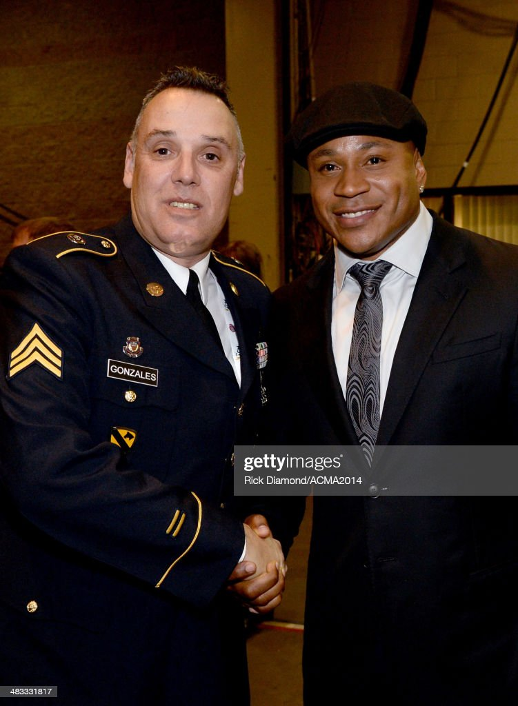 Actor LL Cool J and a member of the United States Army attend ACM Presents An AllStar Salute To The Troops at the MGM Grand Garden Arena on April 7...