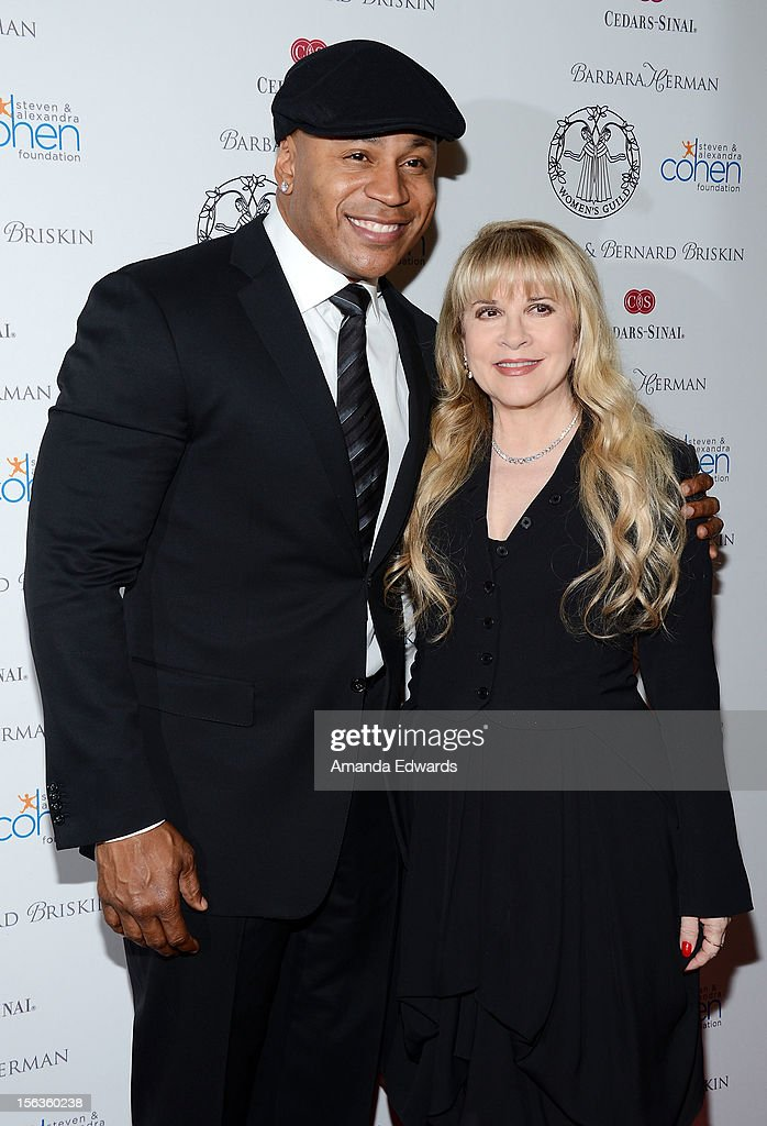 Actor <a gi-track='captionPersonalityLinkClicked' href=/galleries/search?phrase=LL+Cool+J&family=editorial&specificpeople=201567 ng-click='$event.stopPropagation()'>LL Cool J</a> (L) and singer <a gi-track='captionPersonalityLinkClicked' href=/galleries/search?phrase=Stevie+Nicks&family=editorial&specificpeople=212751 ng-click='$event.stopPropagation()'>Stevie Nicks</a> arrive at the 55th Annual Women's Guild Cedars-Sinai Anniversary Gala at the Beverly Wilshire Four Seasons Hotel on November 13, 2012 in Beverly Hills, California.