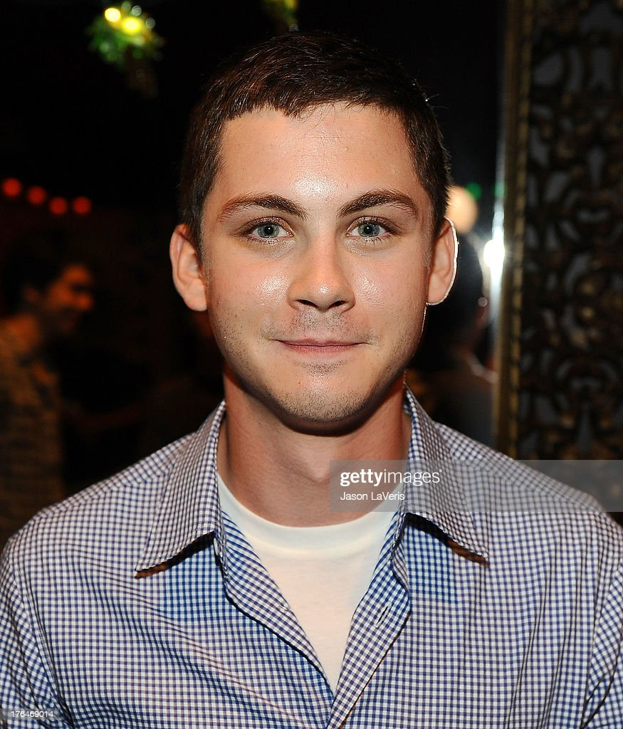 Actor Logan Lerman poses in the green room at the 2013 Teen Choice Awards at Gibson Amphitheatre on August 11, 2013 in Universal City, California.