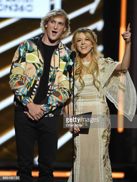 Actor Logan Paul and recording artist Lindsey Stirling present an award during the 2017 Billboard Music Awards at TMobile Arena on May 21 2017 in Las...