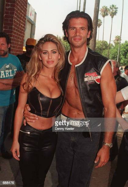 Actor Lorenzo Lama and his wife Shauna Sands attend a ''Harley Love Ride'' August 17 1996 in Los Angeles CA