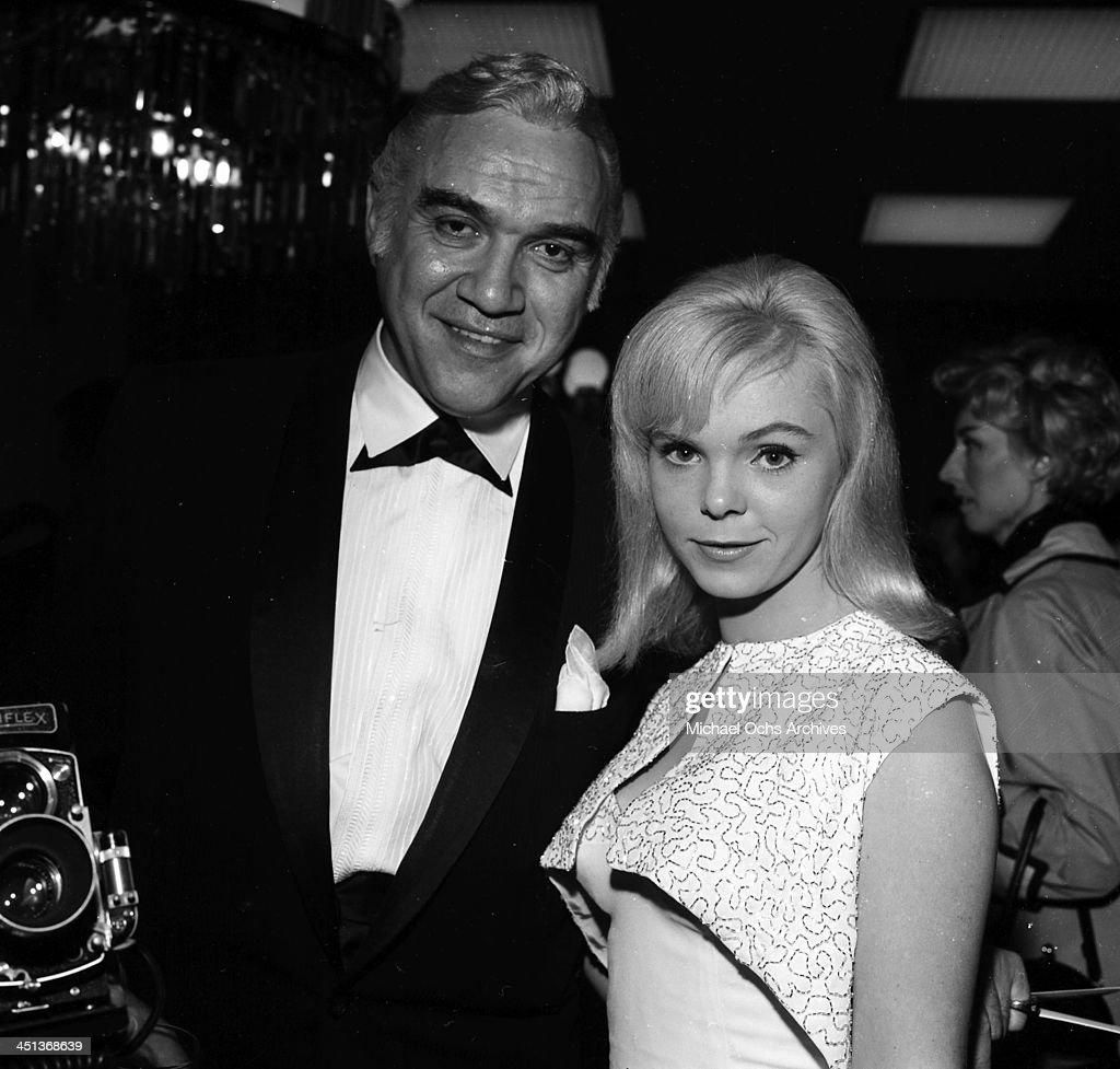 Actor Lorne Greene and his guest attend a party in Los Angeles, California.