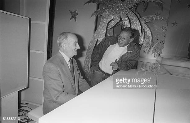 Actor Louis de Funes and singer Henri Salvador share a laugh together They are appearing on the French television show ChampsElysees