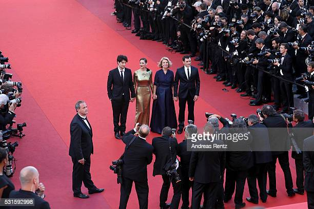Actor Louis Garrel actress Marion Cotillard director Nicole Garcia and actor Alex Brendemuehl attend the 'From The Land Of The Moon ' premiere during...