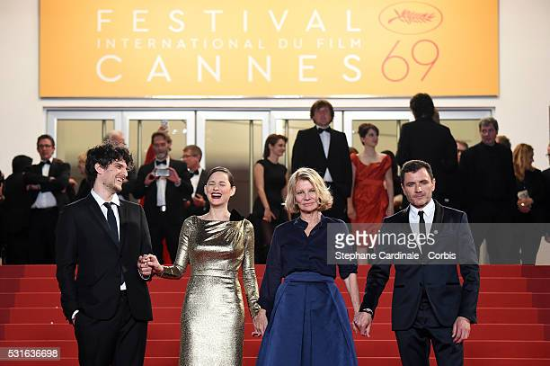 Actor Louis Garrel actress Marion Cotillard director Nicole Garcia and actor Alex Brendemuehl leave the 'From The Land Of The Moon ' premiere during...