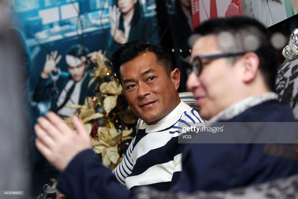 Actor Louis Koo (L) and producer Nai-Hoi Yau receive interview for movie 'Three' on June 21, 2016 in Guangzhou, China.
