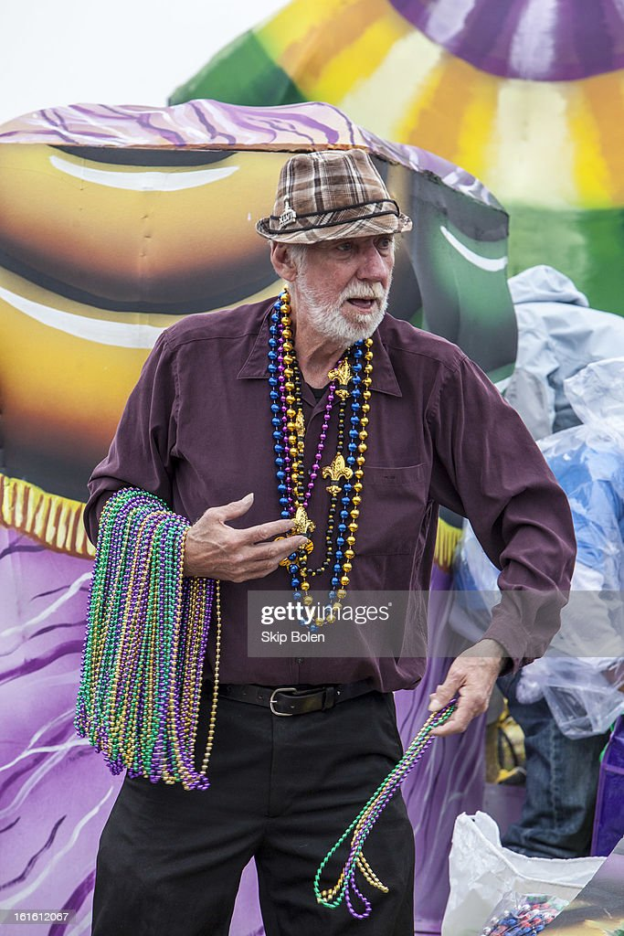 Actor Lowell Landes of 'Beasts of the Southern Wild' tosses beads to fans and revelers in the Krewe of Argus Mardi Gras Parade on February 12, 2013 in New Orleans, Louisiana.