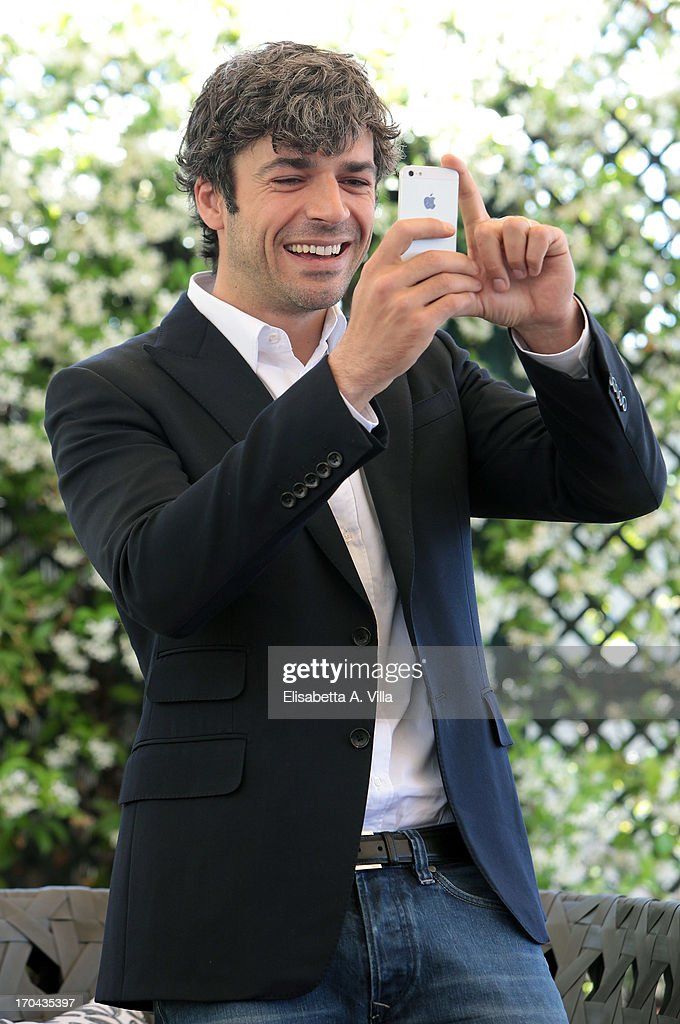 Actor <a gi-track='captionPersonalityLinkClicked' href=/galleries/search?phrase=Luca+Argentero&family=editorial&specificpeople=3966791 ng-click='$event.stopPropagation()'>Luca Argentero</a> takes a photo with his iPhone as he attends 'Cha Cha Cha' photocall at Hotel Bernini Bristol on June 13, 2013 in Rome, Italy.