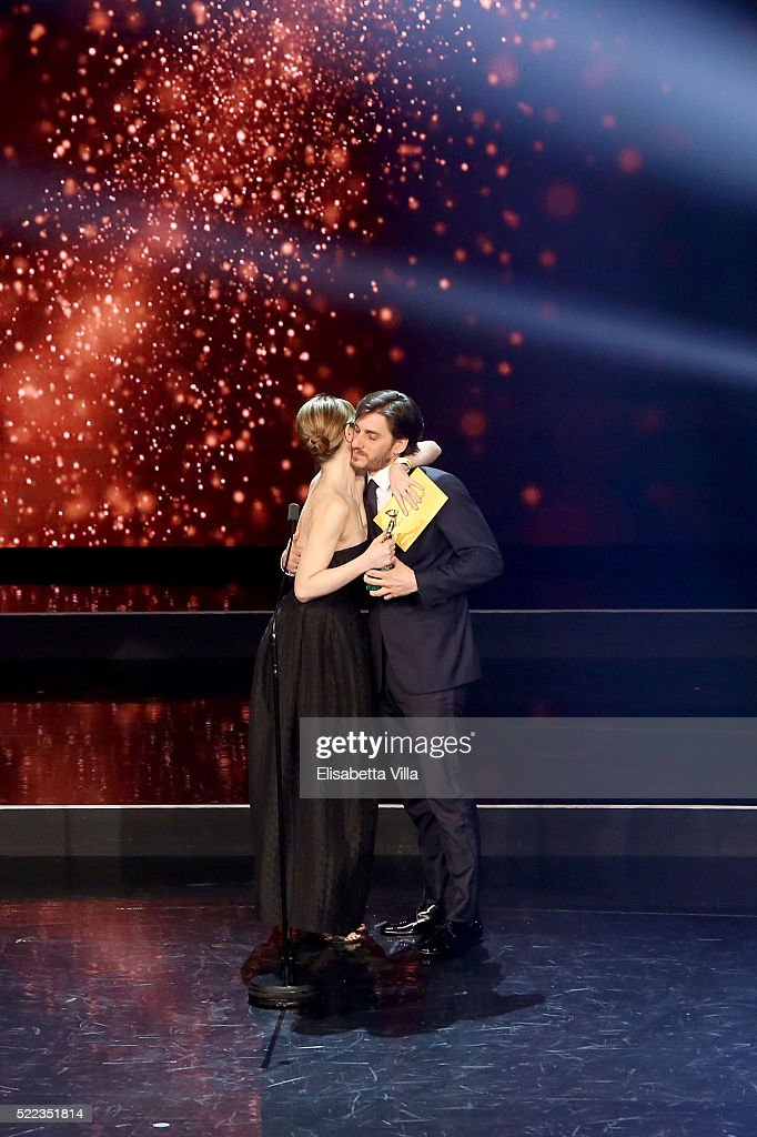 Actor <a gi-track='captionPersonalityLinkClicked' href=/galleries/search?phrase=Luca+Marinelli&family=editorial&specificpeople=7179366 ng-click='$event.stopPropagation()'>Luca Marinelli</a> receives the Best Supporting Actor award from <a gi-track='captionPersonalityLinkClicked' href=/galleries/search?phrase=Paola+Cortellesi&family=editorial&specificpeople=2856711 ng-click='$event.stopPropagation()'>Paola Cortellesi</a> during the 60. David Di Donatello awards ceremony on April 18, 2016 in Rome, Italy.