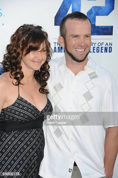 Actor lucas black and wife maggie o brien arrive at the premiere of 42