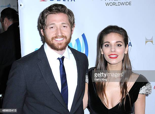 Actor Lucas Neff and actress Caitlin Stasey attend the 25th annual GLAAD Media Awards on April 12 2014 at The Beverly Hilton Hotel in Beverly Hills...