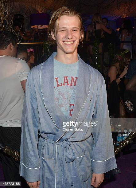 Actor Lucas Till attends the Annual Midsummer Night's Dream Party at the Playboy Mansion hosted by Hugh Hefner on August 16 2014 in Holmby Hills...