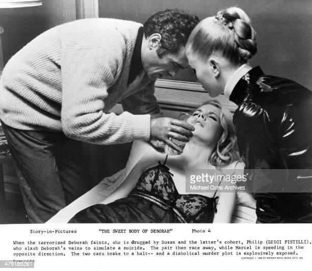 Actor Luigi Pistilli actress Carroll Baker and Ida Galli in a scene from the movie 'The Sweet Body of Deborah' circa 1968
