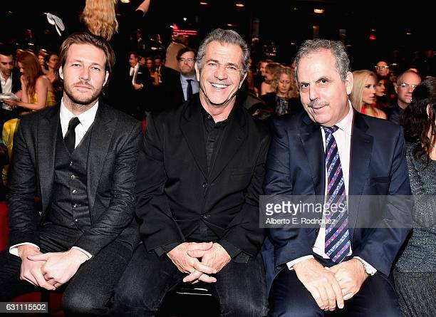 Actor Luke Bracey director Mel Gibson and producer Bill Mechanic attend the 6th Annual AACTA International Awards at Avalon Hollywood on January 6...