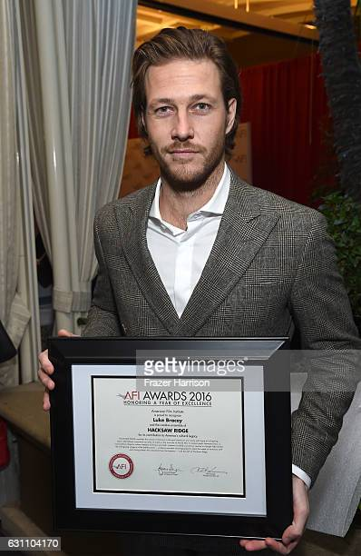 Actor Luke Bracey poses with award during the 17th annual AFI Awards at Four Seasons Los Angeles at Beverly Hills on January 6 2017 in Los Angeles...