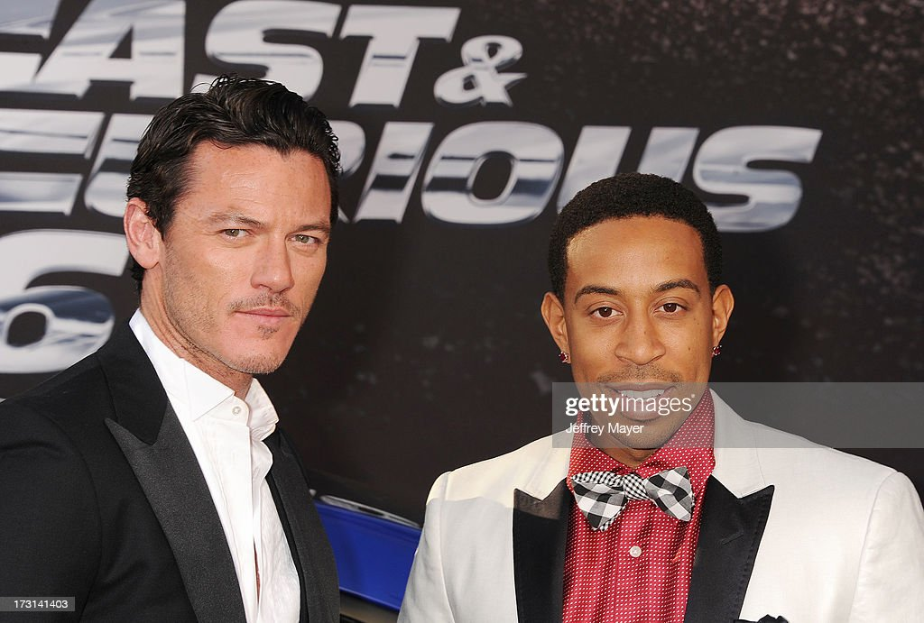 Actor Luke Evans (L) and Chris 'Ludacris' Bridges arrive at the 'Fast & The Furious 6' Los Angeles premiere at Gibson Amphitheatre on May 21, 2013 in Universal City, California.