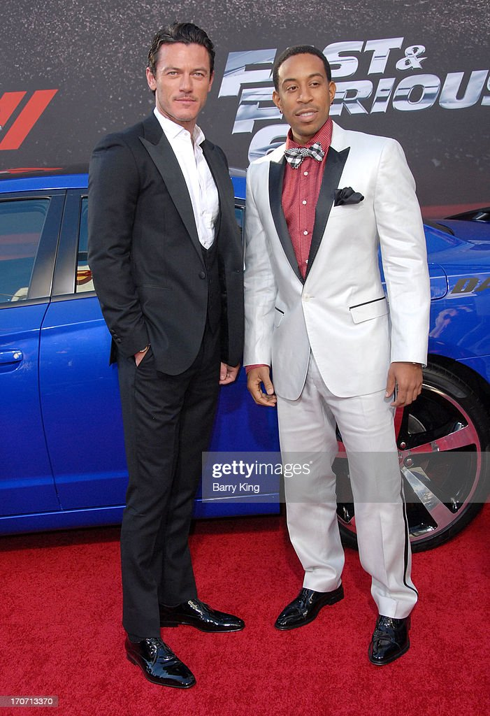 Actor Luke Evans (L) and rapper/actor Chris 'Ludacris' Bridges attend the premiere of 'Fast & Furious 6' at Universal CityWalk on May 21, 2013 in Universal City, California.