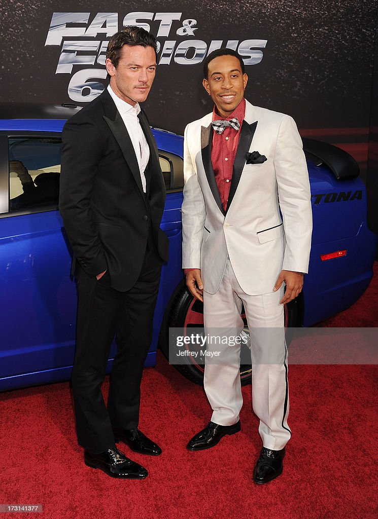 Actor Luke Evans; Chris 'Ludacris' Bridges arrive at the 'Fast & The Furious 6' Los Angeles premiere at Gibson Amphitheatre on May 21, 2013 in Universal City, California.
