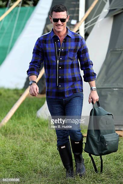 Actor Luke Evans wearing Coach attends the Glastonbury Festival at Worthy Farm Pilton on June 23 2016 in Glastonbury England