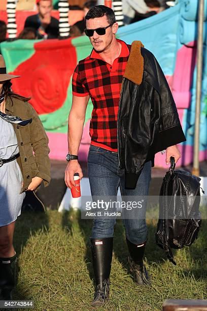 Actor Luke Evans wearing Coach attends the Glastonbury Festival at Worthy Farm Pilton on June 24 2016 in Glastonbury England