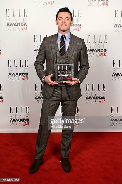 Actor Luke Evans winner of the Actor of the Year Award poses in the winners room during the Elle Style Awards 2015 at Sky Garden @ The Walkie Talkie...
