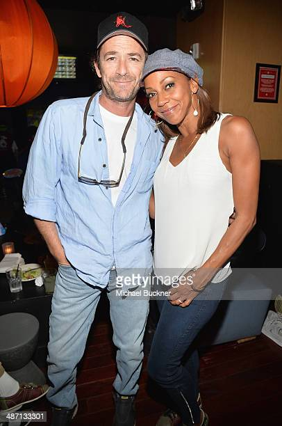 Actor Luke Perry and actress Holly Robinson Peete attends Audi Best Buddies' Bowling For Buddies at Lucky Strike Lanes at LA Live on April 27 2014 in...