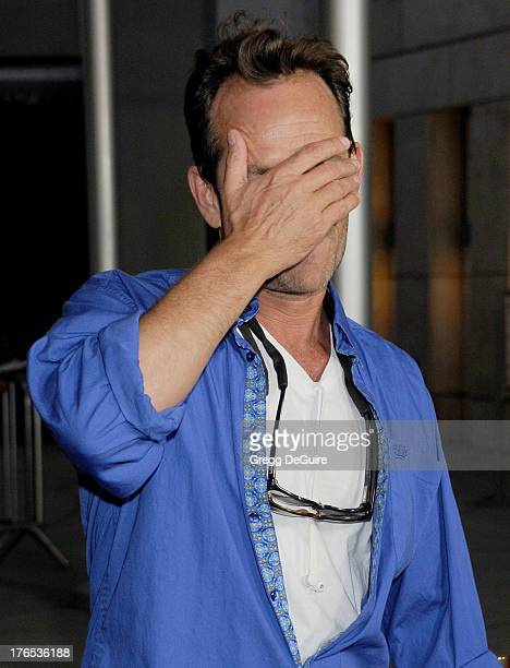 Actor Luke Perry arrives at the Los Angeles premiere of 'Dark Tourist' at ArcLight Hollywood on August 14 2013 in Hollywood California
