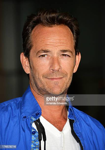Actor Luke Perry arrives at the premiere of 'Dark Tourist' at ArcLight Hollywood on August 14 2013 in Hollywood California