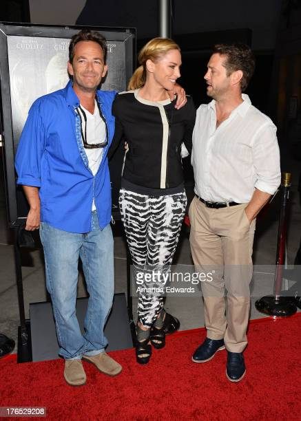 Actor Luke Perry Naomi LowdePriestley and actor Jason Priestley arrive at the premiere of 'Dark Tourist' at ArcLight Hollywood on August 14 2013 in...