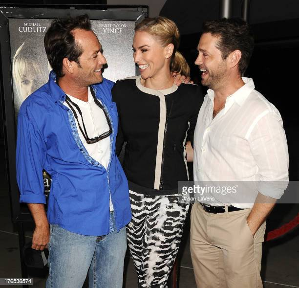 Actor Luke Perry Naomi LowdePriestley and actor Jason Priestley attend the premiere of 'Dark Tourist' at ArcLight Hollywood on August 14 2013 in...