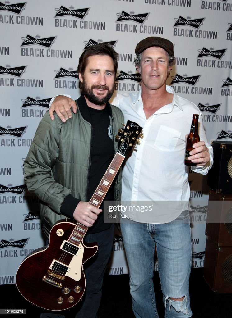 Actor Luke Wilson and Director of Entertainment Marketing, Anheuser-Busch Jim Holleran attend the Budweiser Black Crown Launch Party at gibson/baldwin showroom on February 13, 2013 in Los Angeles, California.
