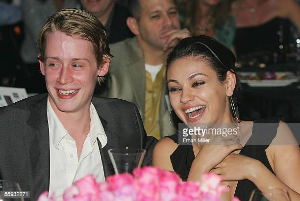 Actor Macaulay Culkin and actress Mila Kunis attend the launch of the 'uBid for Hurricane Relief' charity auction and benefit at the Empire Ballroom...