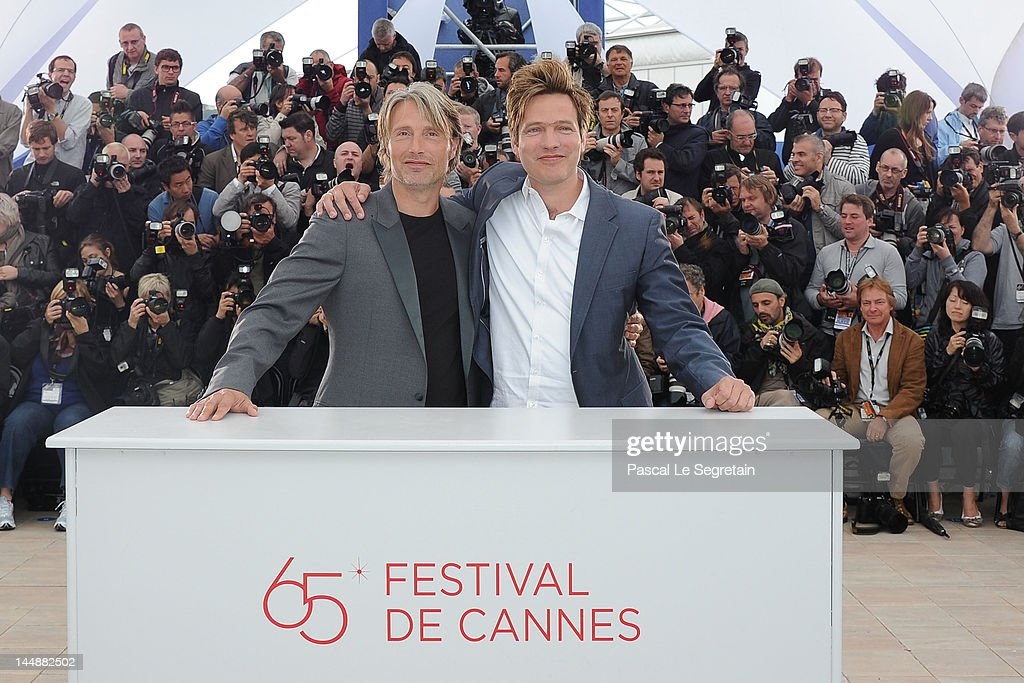 Actor Mads Mikkelsen and director Thomas Vinterberg pose at the 'Jagten' Photocall during the 65th Annual Cannes Film Festival at Palais des...