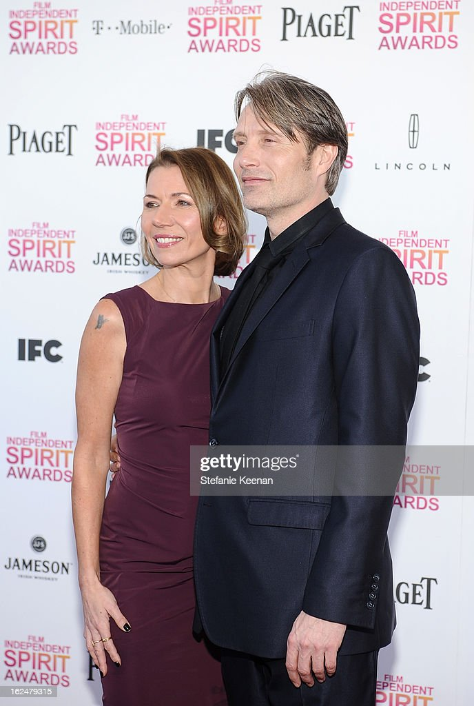 Actor Mads Mikkelsen (R) and Hanne Jacobsen arrive at The 2013 Film Independent Spirit Awards on February 23, 2013 in Santa Monica, California.