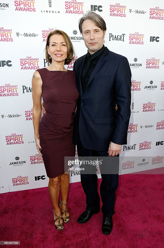 Actor Mads Mikkelsen (R) and Hanne Jacobsen attend the 2013 Film Independent Spirit Awards at Santa Monica Beach on February 23, 2013 in Santa Monica, California.