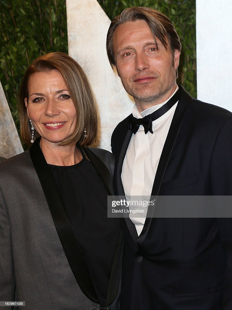 Actor Mads Mikkelsen (R) and wife Hanne Jacobsen attend the 2013 Vanity Fair Oscar Party at the Sunset Tower Hotel on February 24, 2013 in West Hollywood, California.
