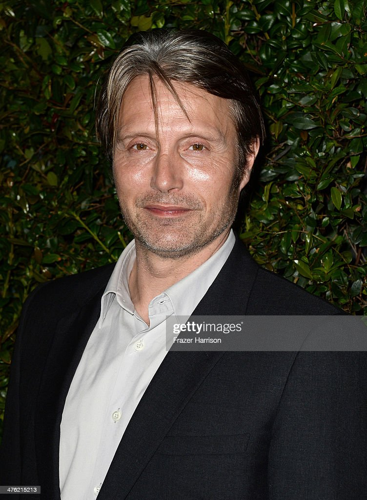 Actor Mads Mikkelsen attends the Chanel and Charles Finch Pre-Oscar Dinner at Madeo Restaurant on March 1, 2014 in Los Angeles, California.